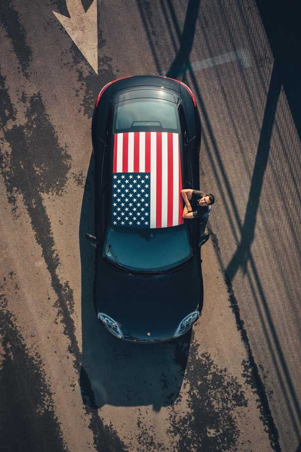 For_the_final_Triple_Demo_Run_the_Taycan_did_the_hot_laps_in_New_York_with_a_stars___stripes_livery