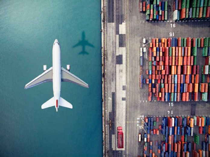 Airplane+flying+over+container+port