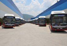 Buses-heading-to-Baku-from-the-BMC-facility,-Izmir-Turkey